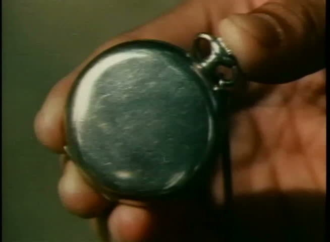 Close-up of hand opening pocket watch