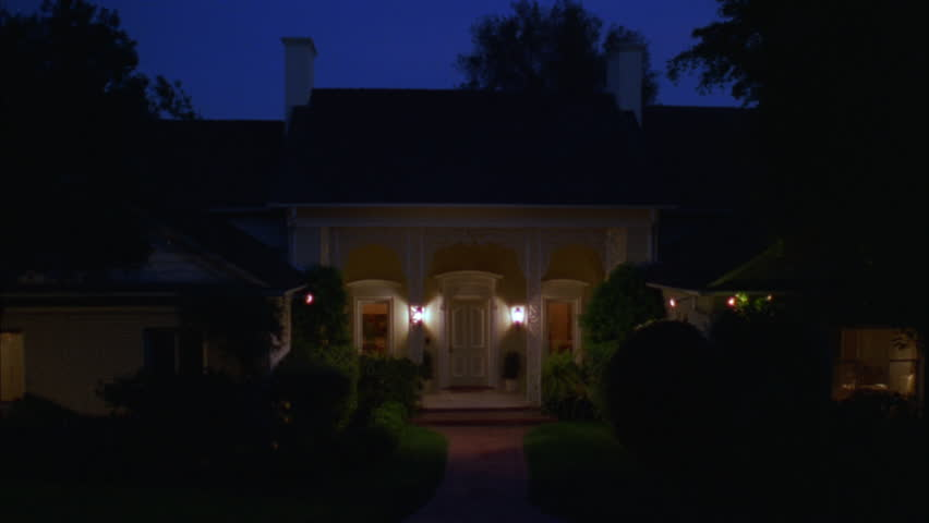 DUSK Magic Hour Night One Story Yellow House White Trim Fancy Lace Style  Wrought Iron Columns