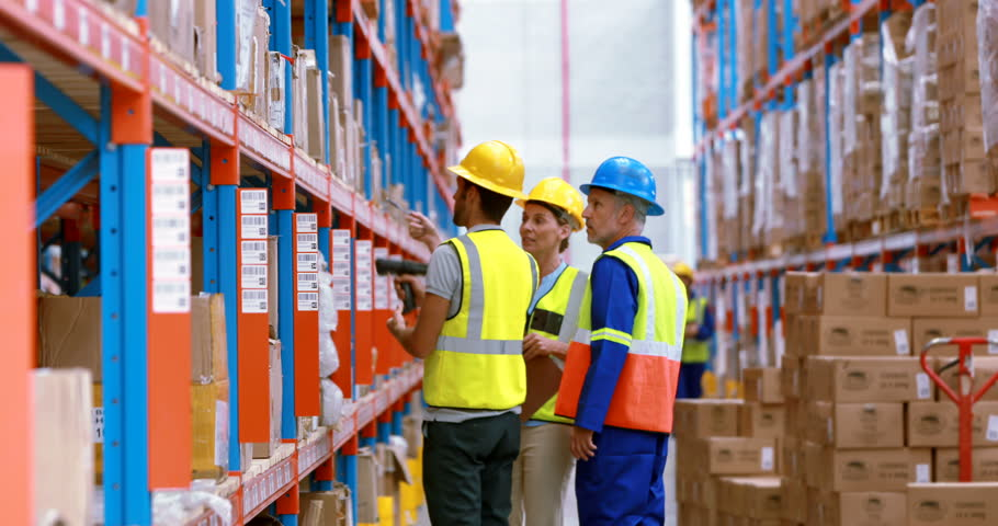 Male and female warehouse worker carrying cardboard boxes in male and female warehouse worker inspecting stock in warehouse 4k 4k stock video clip sciox Choice Image