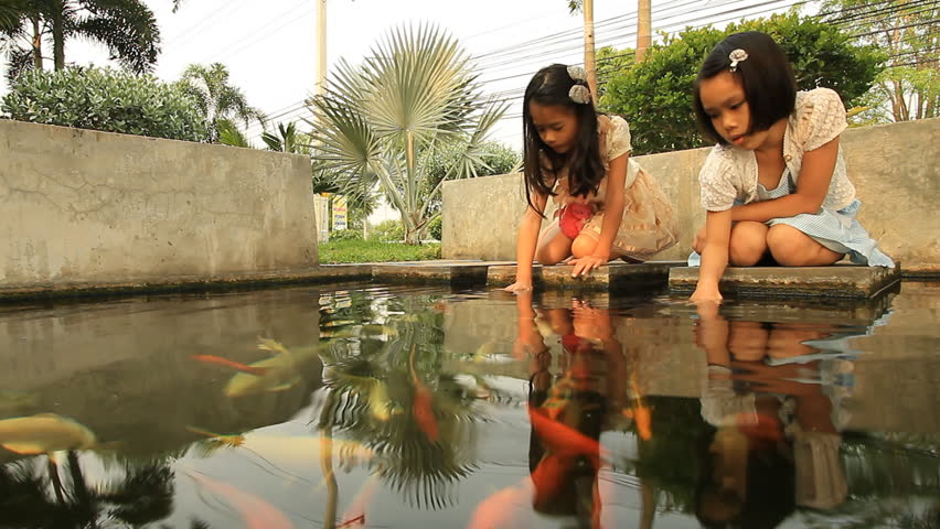 Asian girls with a fish pond.