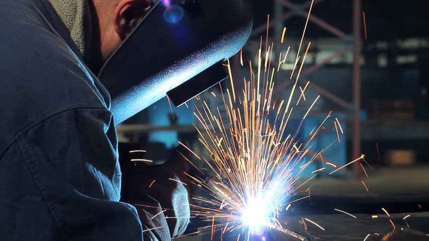 Welder at work in metal industry
