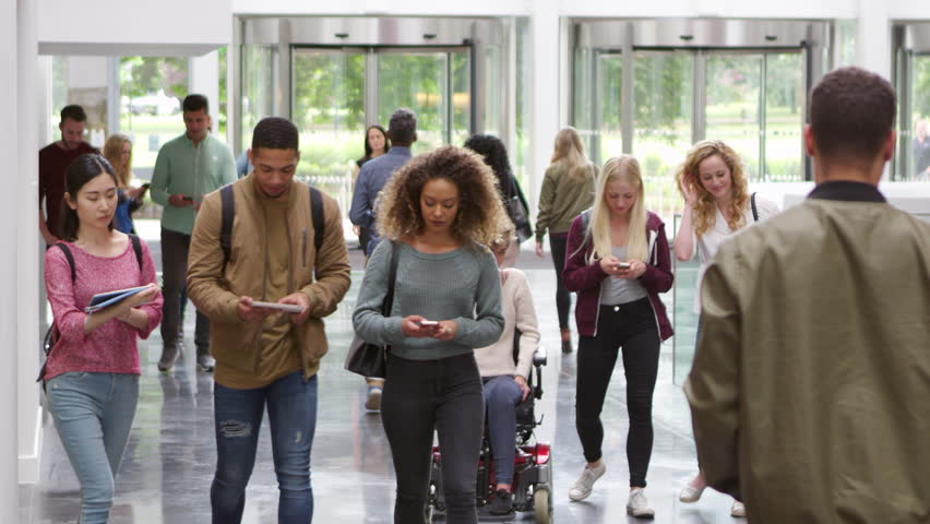 Students walking through the foyer of a modern university, shot on R3D
