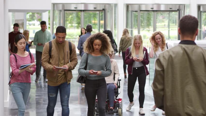 Students walking through the foyer of a modern university, shot on R3D | Shutterstock HD Video #21195964