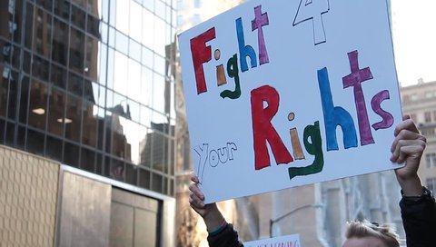 New York, N.Y. November 12, 2016: Protesters on Fifth Avenue near Trump Tower Protest Trump Election ChantIng Not My President,  Donald Trump Go Away and We Reject the President Elect