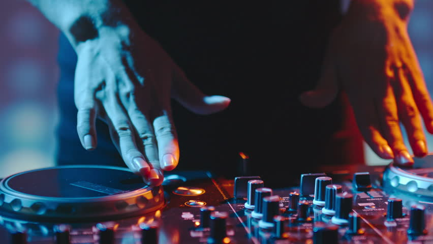 Close up of female hands turning knobs on professional DJ mixer console | Shutterstock HD Video #21260215
