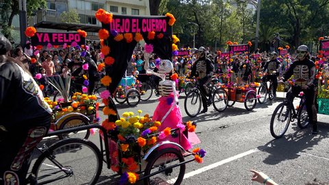 MEXICO CITY, MEXICO - OCTOBER 29, 2016: Day of the Dead Parade Bikers With Flower Baskets