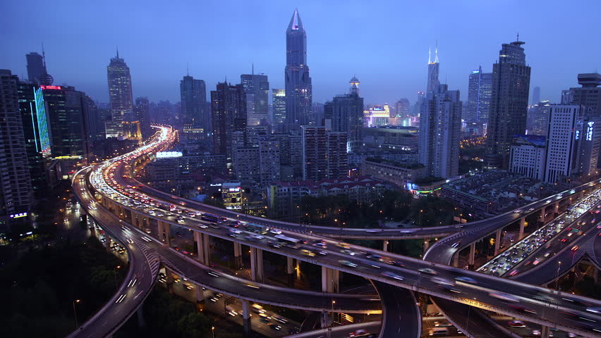 Shanghai, China - March 2016: Time lapse of busy elevated road junction & skyline at dusk #21319408