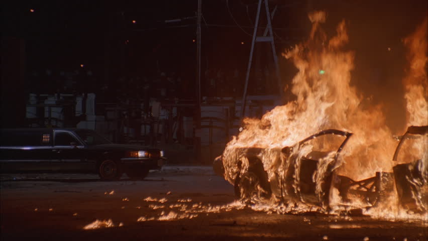 Night Dark Dirt lot parked black limo light car sedan Power plant generators background Sedan explodes, burns blazing fire Slow limo drives away, burning car | Shutterstock HD Video #21322708