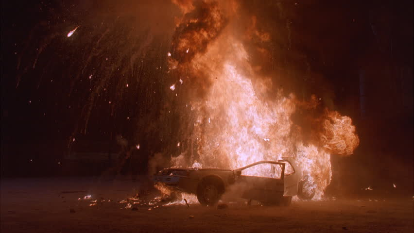 Night Burning car light sedan dirt lot, blazing fire Explodes, huge fireball 2nd explosion destroys car Black limo slowly through background murder, news footage, playback, mafia | Shutterstock HD Video #21322717