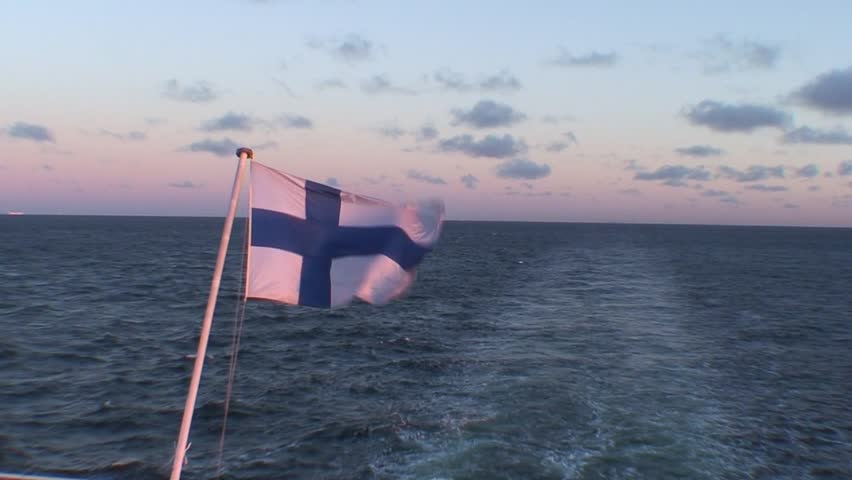 HDTV: Finnish flag on passenger cruise ship at sunrise, close-up - HD stock video clip