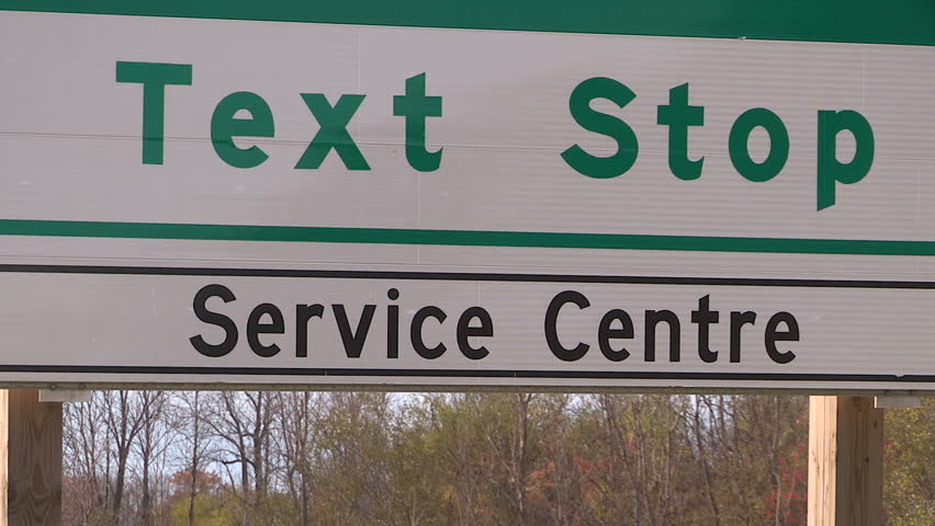 Cambridge, Ontario, Canada November 2016 Anti texting and driving rest stop sign on highway | Shutterstock HD Video #21339118