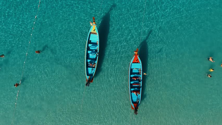 Aerial: Two long tail boats on the beach. | Shutterstock HD Video #21374725
