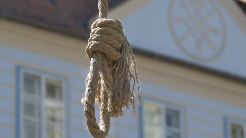 Close up shot om hanging rope moving in the wind on sunny day. #21387694