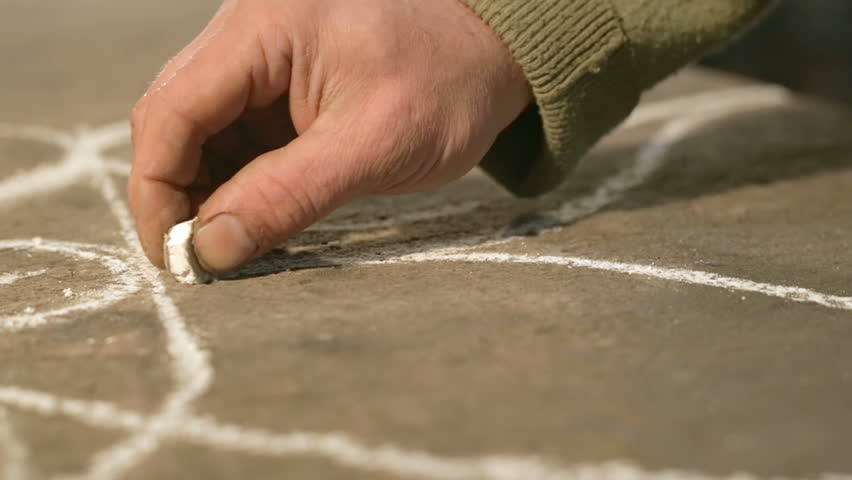 Close-up hand of a young blacksmith who draws a chalk sketch on the table   Shutterstock HD Video #21392038