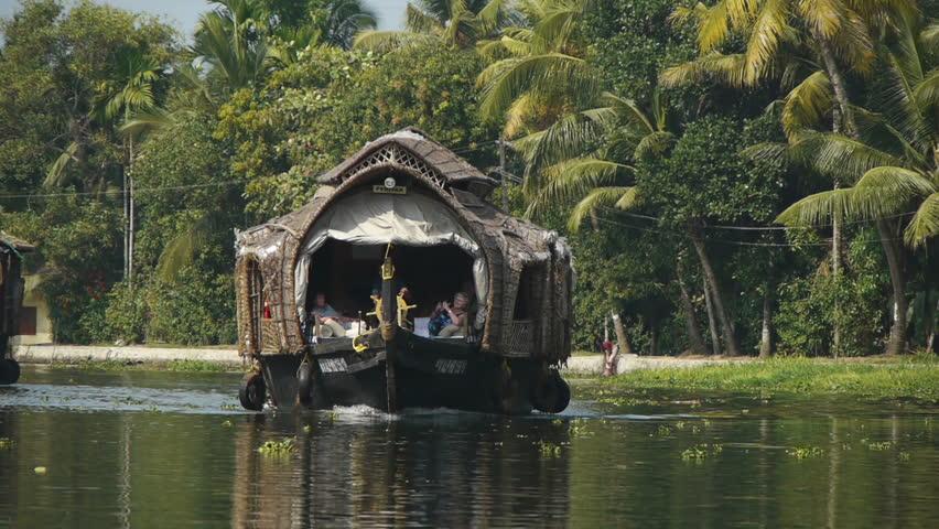 INDIA, KERALA - FEB 12: Fishermen in houseboat on the coast of the Kerala backwaters on February 12, 2012 in Kerala, India.