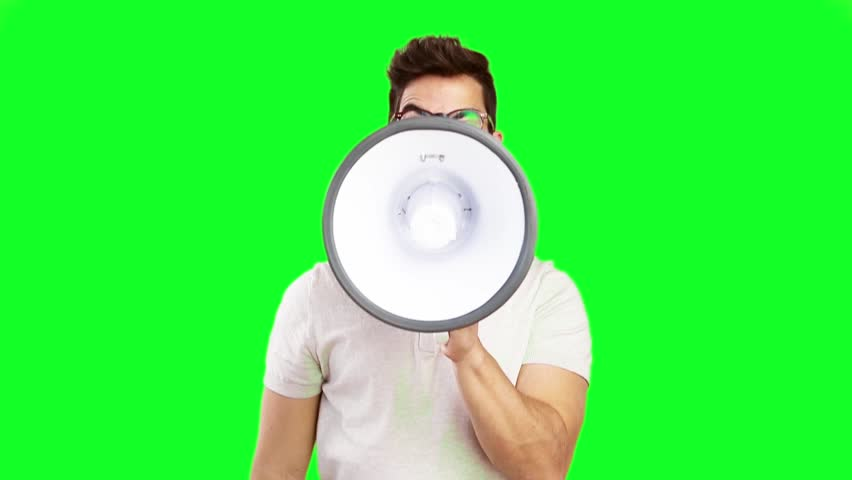 Young man shouting on megaphone on green screen