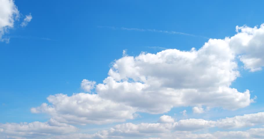 white clouds soar across the screen in time lapse #21463948