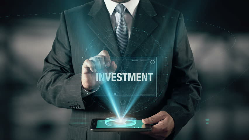 Businessman with Investment concept choose Stocks from Antiques Metals Bonds Real Estate Mutual Funds using digital tablet | Shutterstock HD Video #21477298