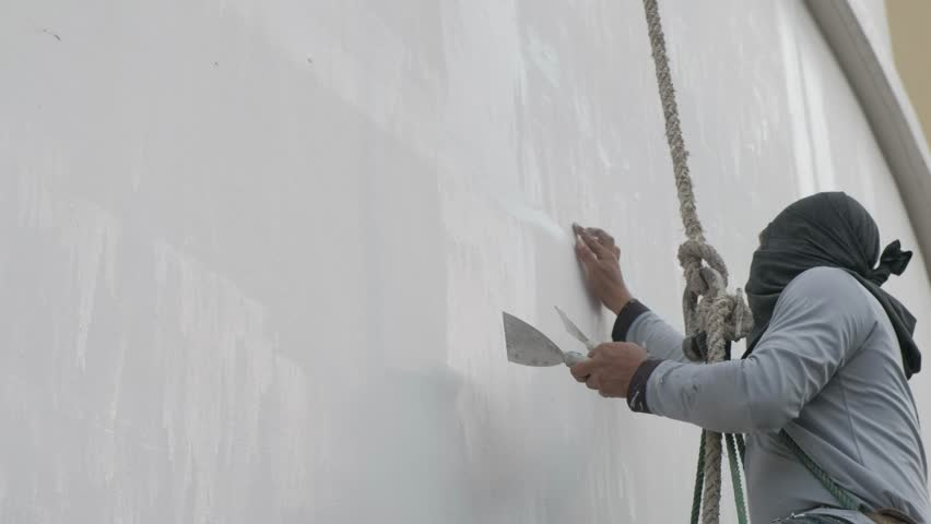 exterior joint compound. bangkok - 19 november:professionals construction workers are painting the exterior of building on joint compound r