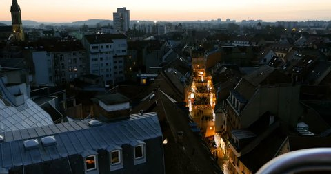 MULHOUSE, FRANCE - CIRCA 2016: Aerial view flight over illumination street with Christmas Market lights and people having fun - drone aerial footage