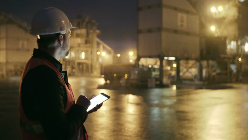 Engineer in hardhat checking the loading of truck with a tablet computer on heavy industry factory | Shutterstock HD Video #21491668