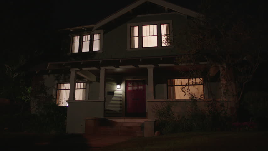 night nice two story craftsman house, wood house light green, porch, all red door, all lights then one upstairs light turns upstairs light turns off, then right downstairs light turns (Sep 2013)
