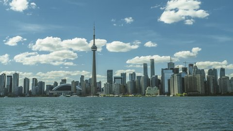 Toronto, Canada - CIRCA: September 2016: Hyperlapse dolly zoom motion timelapse of the Toronto City Skyline with rolling clouds and blue skies. Shot from Toronto Islands Ferry.