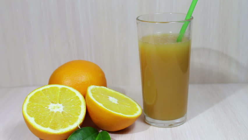 Orange Juice In A Glass And Fresh Fruits On Wooden Background   HD Stock  Footage Clip