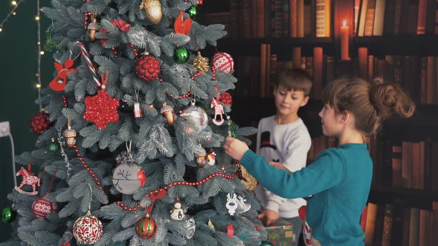 Happy Kid Girl Dressing Up Christmas Tree On White Background ...