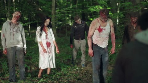 Zombies eat a man in the forest. HD