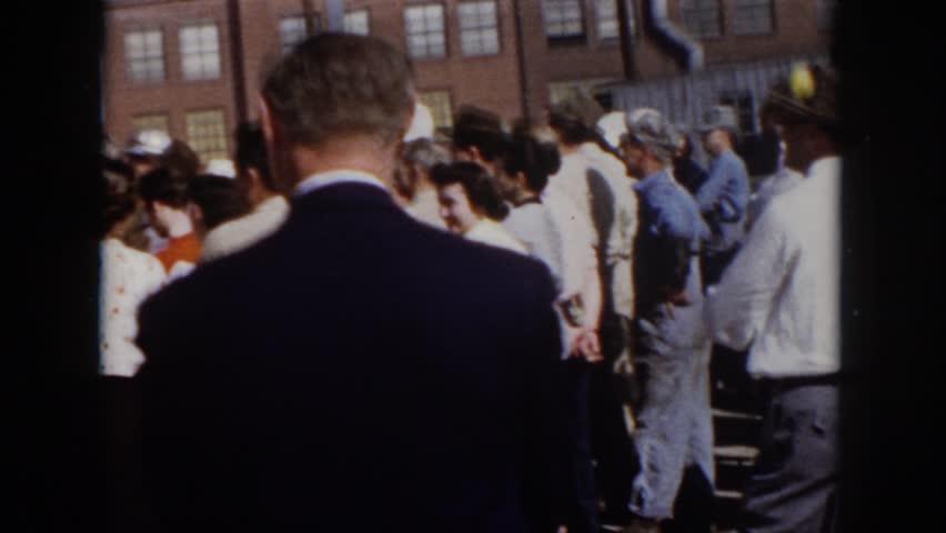 VIRGINIA 1958: an old man in a suit walking in a crowd, is he a terrorist?   Shutterstock HD Video #21617188