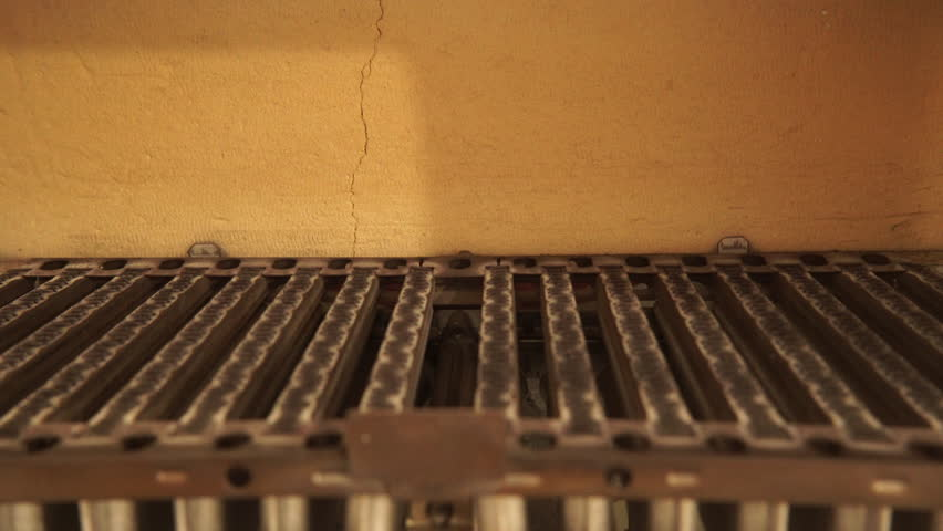 Heating at home. Blue flames of gas burner being burning, closeup detail  inside of
