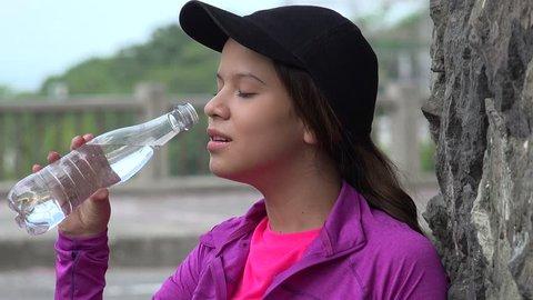 Teen Girl Drinking Bottled Water