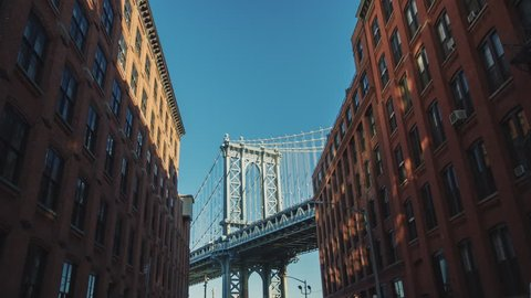 Manhattan Bridge Motion Timelapse. The camera moves to the famous bridge from Brooklyn. You can key sky for your background