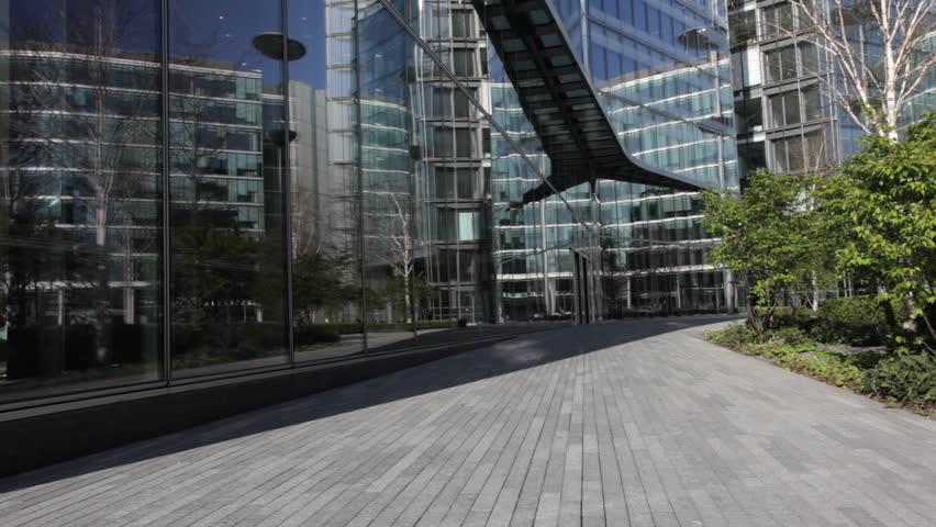 Runner, passing business offices, London, UK