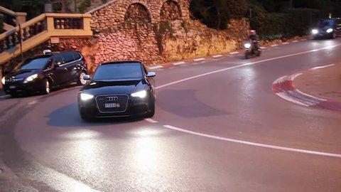 Monte-Carlo, Monaco - January 20, 2016: Luxury Black Audi S8 Driving Around the Fairmont Famous Hairpin Turn in Monte-Carlo, Monaco in The French Riviera