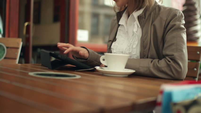 Woman with tablet computer in cafe