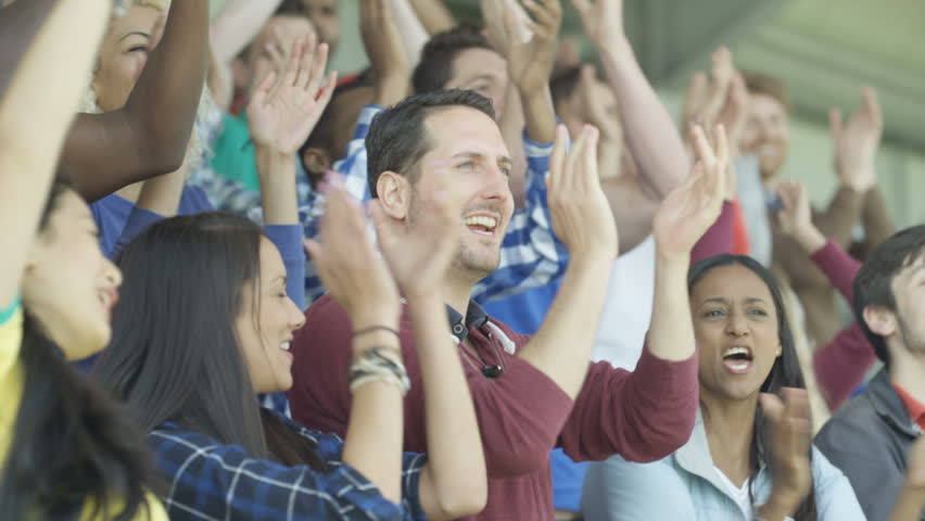 4K Excited sports fans at live game chanting and cheering for their team (UK-Oct 2016)