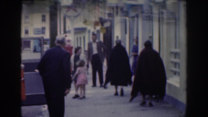 DUBLIN IRELAND 1961: people milling about on a side street in a city | Shutterstock HD Video #21752278