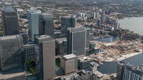 4k aerial view of the london docklands skyline from a helicopter