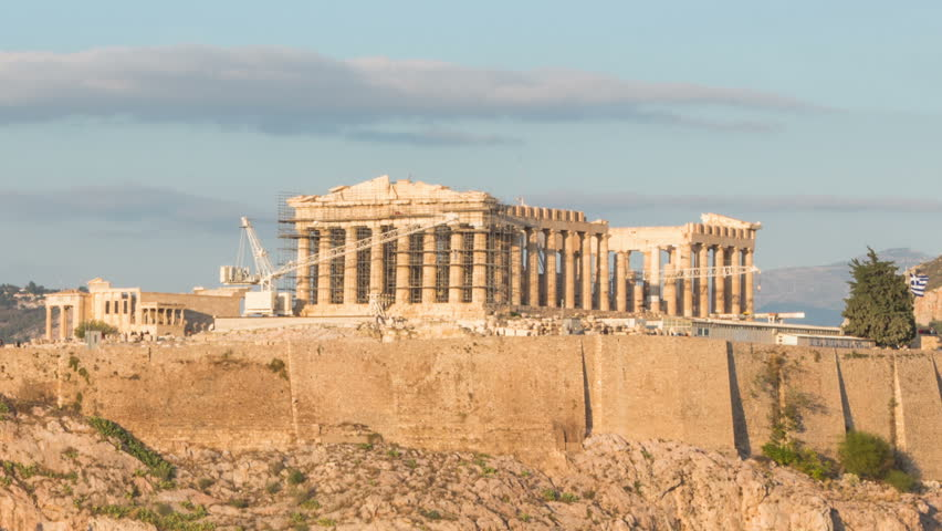 Time lapse of the Acropolis at sunset view from Filopappou hill zoom out motion