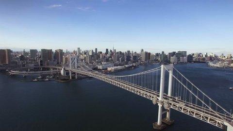 Beautiful Tokyo Rainbow Bridge aerial left movement Tower background