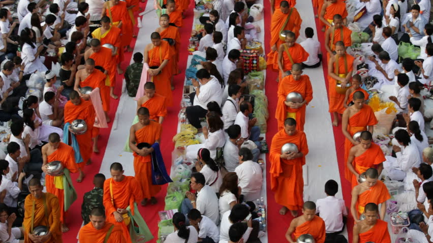 BANGKOK, MARCH 18, 2012: Monks are participating in a Mass Alms Giving of 12,600 monks for the Makha Bucha celebrations in Bangkok, Thailand  on March 17, 2012.