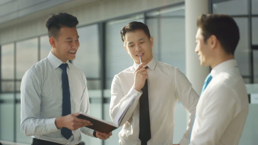 4K Businessmen talking shake hands in crowded area of large modern office (UK-Oct 2016) | Shutterstock HD Video #21774586