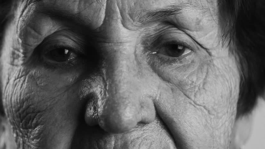 Blac and white shot close-up of wrinkled face of an old woman