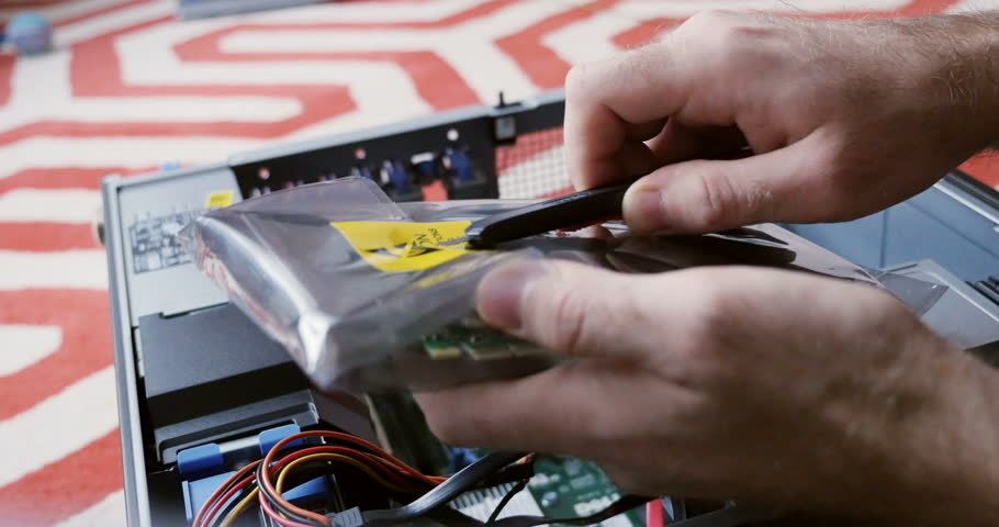 PARIS, FRANCE - CIRCA 2016: Fastmotion unpacking NVidia Quadra computer card for workstation upgrading computer with powerful NVidia Quadro graphic card for extreme video content processing