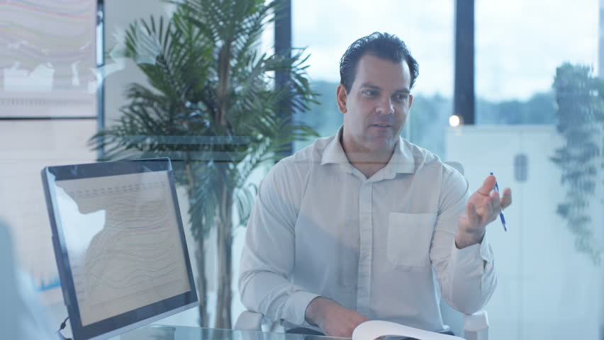 4K Businessman in a meeting with colleagues in modern glass office (UK-Oct 2016) | Shutterstock HD Video #21843958