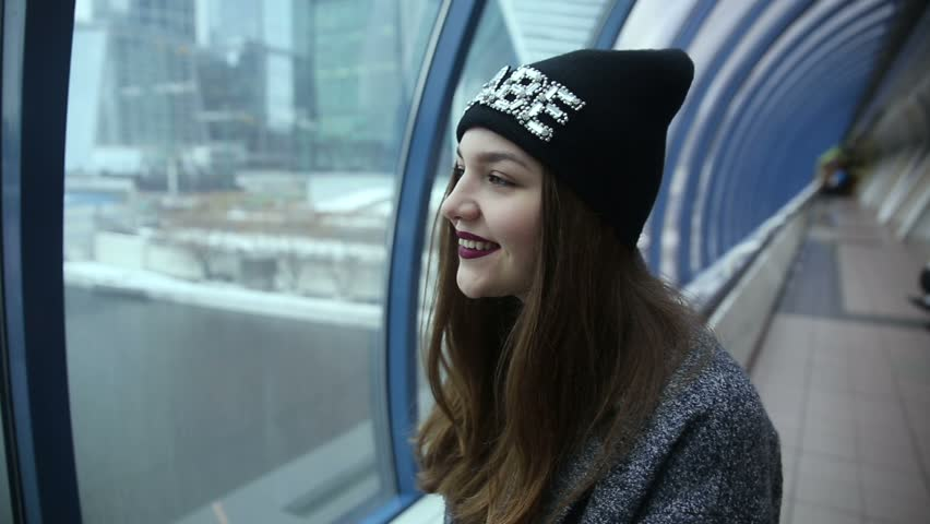 A girl looks out the window | Shutterstock HD Video #21846508