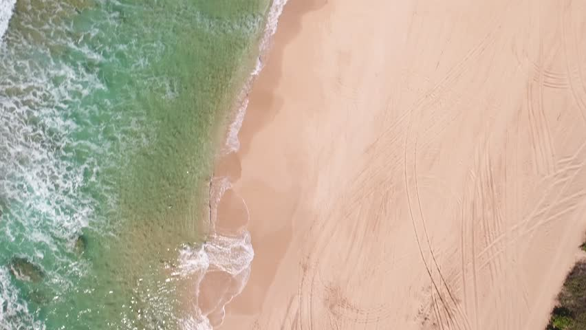 Overhead View of Jeep on Beach with Waves Crashing | Shutterstock HD Video #21880828