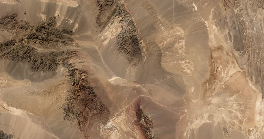 High-altitude overflight aerial of rocky desert in the  Yazd and Khorasan provinces of Iran. Clip loops and is reversible. Elements of this image furnished by NASA